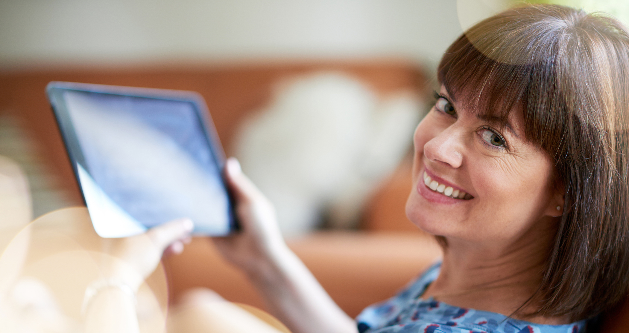Happy women with a digital tablet in her hand